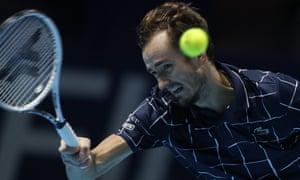 Daniil Medvedev returns the ball to Rafael Nadal .