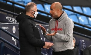 Manchester City manager Pep Guardiola argues with the fourth official.