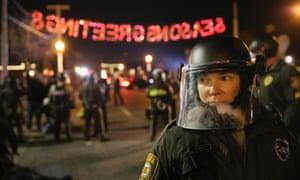 Police confront demonstrators in Ferguson