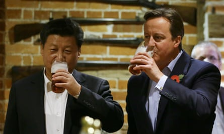 British Prime Minister David Cameron (R) drinks a pint of beer with Chinese President Xi Jinping at a pub in Princess Risborough near Chequers, northwest of London, on October 22, 2015. The two leaders met for talks and dinner this evening during a state visit hailed as a landmark by both China and Britain. AFP PHOTO / POOL / Kirsty WigglesworthKIRSTY WIGGLESWORTH/AFP/Getty Images