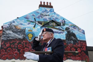 Eric Howden BEM, 76, the chairman of the Redcar Royal British Legion branch, waits in front of a commemorative war mural ahead of the two-minute silence