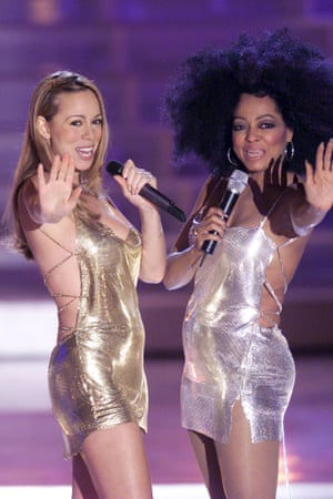 """Performing with Ms. Ross, wearing Versace at the VH1 Divas 2000: Tribute to Diana Ross. The dresses were Mariah's own and a last minute swap for the intended """"hideous green sequinned gowns."""""""