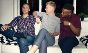 Posed by models group of young people having a party, telling jokes, having a good time, celebrating, in a private home