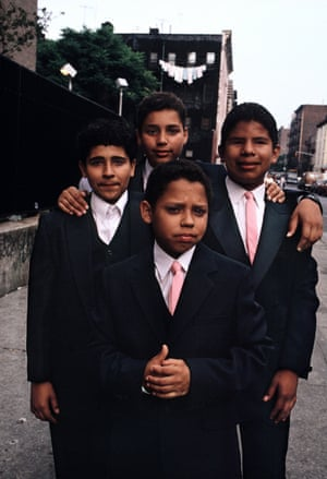 Four young boys wearing suits and ties