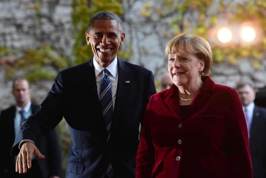 US President Barack Obama is greeted by German Chancellor Angela Merkel upon arrival at the chancellery in Berlin.