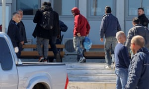 People rescued during the raid are taken to police headquarters in Heraklion on the island of Crete.