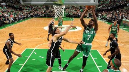 Boston Celtics rookie Jaylen Brown shoots on the Celtics' distinctive red-oak floor.