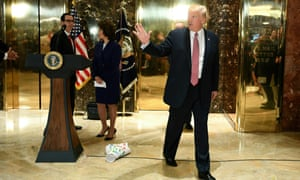 Donald Trump walks away from the podium, with his infrastructure chart left on the floor behind him along with cabinet members Gary Cohn and Elaine Chao.