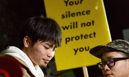 Protesters in front of Japanese prime minister Shinzo Abe's office after the finance ministry admitted altering records linking Abe's wife Akie to a land deal scandal.