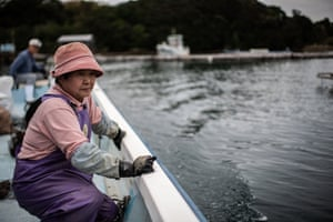 Farmers of the Sakaguchi Akoya pearl farm sail on their boat in Shima