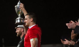 All Blacks' captain Kieran Read and Lions' captain Sam Warburton lift the DHL NZ cup after the series finished a draw.