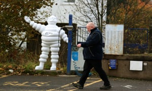 a worker leaves Michelin's Dundee tyre factory