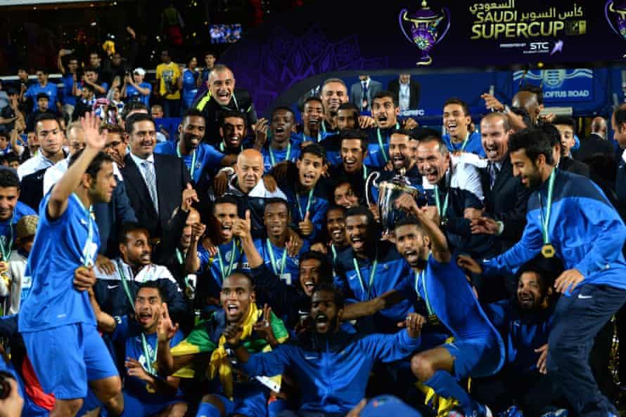 Al-Hilal players and staff celebrate winning the Saudi Super Cup.