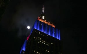 The Super Wolf Blood Moon lunar eclipse begins as the moon rises behind the Empire State Building in New York City