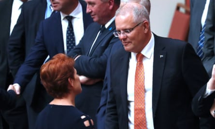 Scott Morrison chats to Pauline Hanson in the Senate.