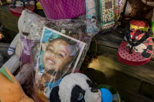 A memorial for 3-year-old Kennedi Powell is seen outside her grandmother's house in south St Louis. The toddler was killed while outside the house in June of this year in a drive-by shooting