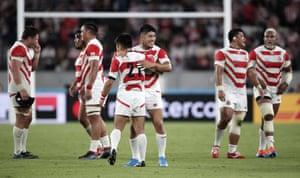 Japan celebrate their 30-10 win.