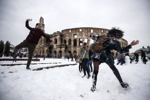 People take part in a snowball fight in front of the Colosseum during a snowfall in Rome, Italy. Snowfall last brought the capital to a standstill for days