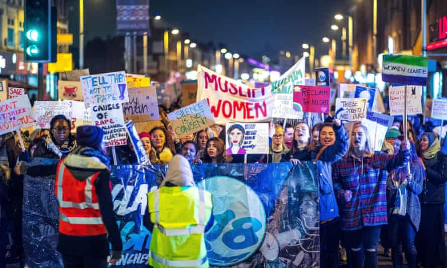 People take part in a Reclaim the Night march in February 2018 to protest against rape, sexual harassment and victim blaming