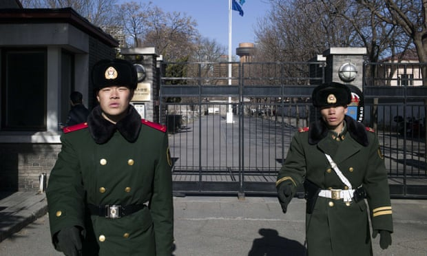 Paramilitary guards stand in front of the gates of Sweden's embassy in Beijing on Wednesday