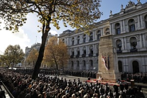 People attend the Remembrance Sunday ceremony at the Cenotaph