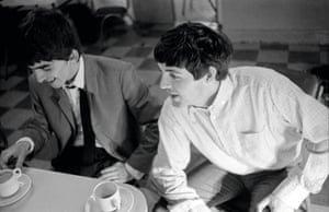 Paul McCartney and guitarist George Harrison during a tea break
