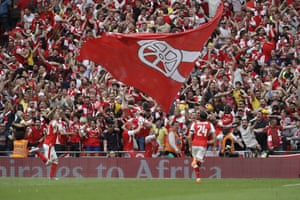 Aaron Ramsey celebrates his goal in front of the happy Arsenal fans