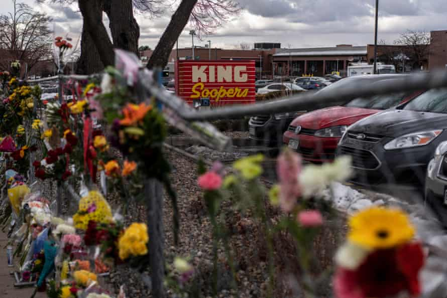 Memorials and flowers are left on the fencing surrounding the King Soopers grocery store where an attacker opened fire.