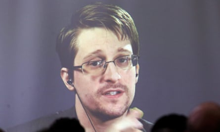 Edward Snowden appears via video link during a conference in Argentina in November 2016.