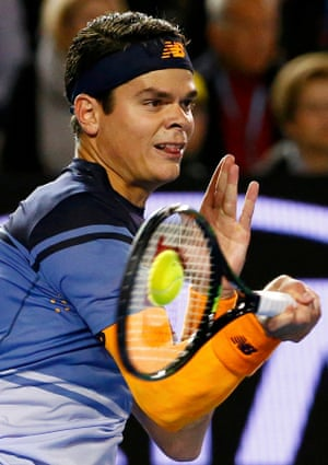 Milos Raonic fires a forehand shot.