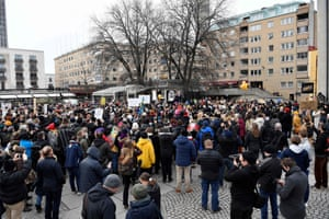 Demonstrators take part in a protest in Stockholm on 6 March 2021 against the measures taken by the Swedish government to fight coronavirus.