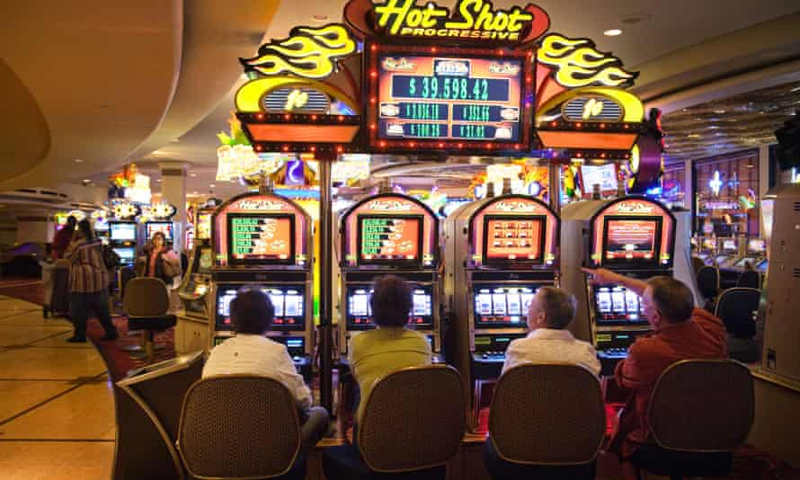 Gamblers at a casino in Las Vegas. The 'Australian-format machine' as it is known in the US now makes up a large percentage of the gambling machines on offer at US casinos.