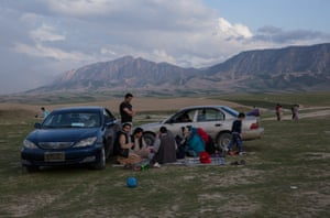 Families ventue out into the foothills of the Hindu Kush mountains, just outside Mazar-e-Sharif city, where they have picnics and listen to music.