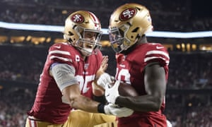 Deebo Samuel, right, and George Kittle celebrate a touchdown in the first half