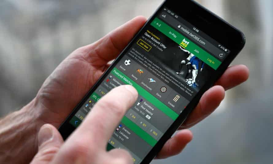 Man betting on smartphone