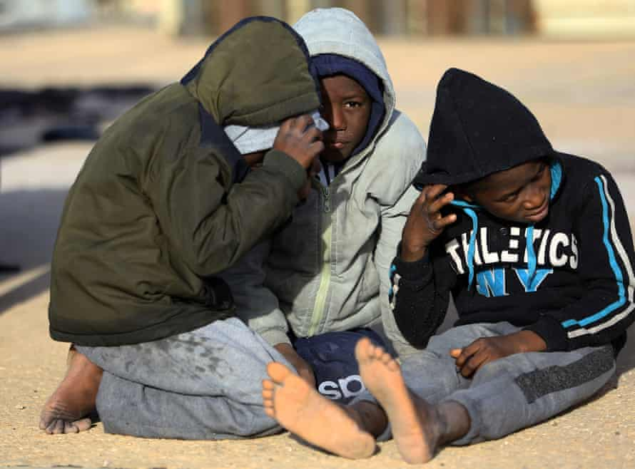 Children wait at a naval base in the Libyan capital, Tripoli, after being rescued off the coast of Garabulli