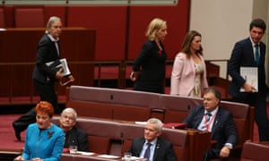 Greens senators walk out of the Senate chamber as Queensland Pauline Hanson delivers her first speech .