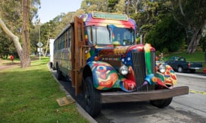 A hippy bus painted in psychedelic colours.
