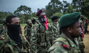 National Liberation Army (ELN) guerrillas stand in formation during a meeting in a remote village in Chocó, Colombia.