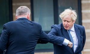 Boris Johnson elbow-bumps a greeting