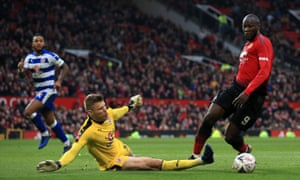 : Romelu Lukaku of Man Utd goes around Reading goalkeeper Anssi Jaakkola before scoring their 2nd goal