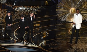 Actor Chris Rock presents children representing accountants from PricewaterhouseCoopers on stage at the 88th Oscars on February 28, 2016 in Hollywood, California. AFP PHOTO / MARK RALSTONMARK RALSTON/AFP/Getty Images