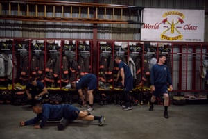 Recruits warm up in front of their turnout lockers before a pre-dawn training session
