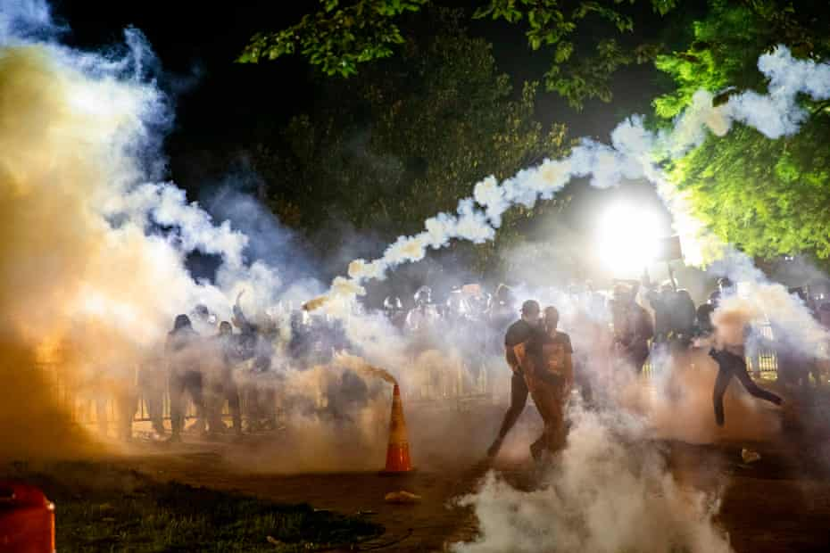 Teargas rises during a demonstration outside the White House over the death of George Floyd, on Sunday.
