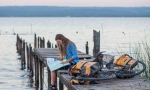 Laura Bingham checks her map during her 7,000km ride.