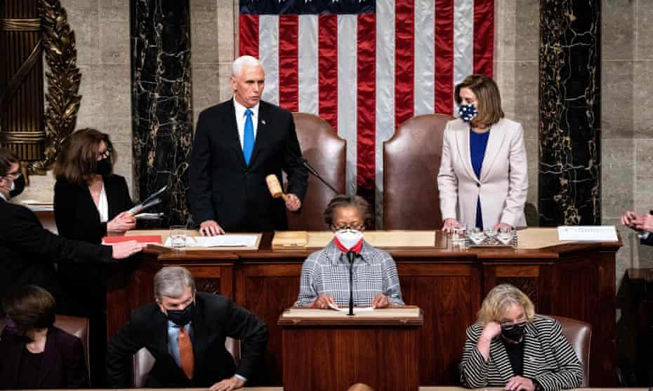 Mike Pence and Nancy Pelosi preside over a joint session of Congress to certify the 2020 electoral college results after a mob stormed the US Capitol on 6 January.