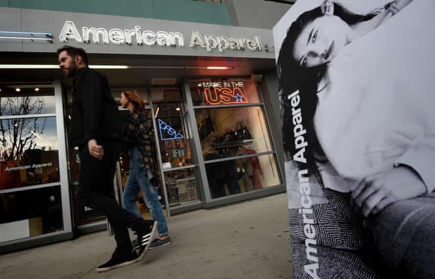 People walk past an American Apparel store in Los Angeles in 2016, after a bankruptcy court approved the company's reorganisation plan.