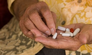 Older person's hand sorting through a handful of medications. Studies show that an absence of medicines reviews increase the risk of falls, adverse drug reactions and being admitted to hospital.