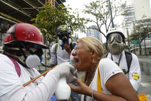 Caracas, Venezuela. Medics assist a woman affected by teargas during the protests