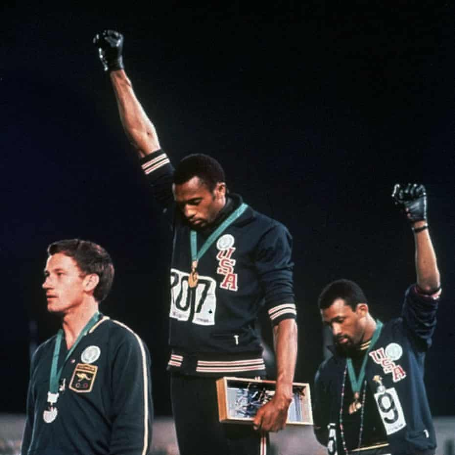 Tommie Smith (centre) with John Carlos (left) and Peter Norman at the Mexico Olympics in 1968.